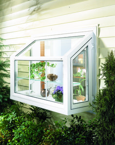 Sundrenched garden windows Exterior view of traditional garden window Kitchen Garden Window, Greenhouse Kitchen, Window Greenhouse, Garden Windows, Kitchen Windows, Raised Bed Garden Design, Garden Design Plans, Window Replacement Cost, Window Cost