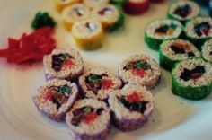 """Candy sushi... fruit roll up on the outside, rice crispy """"dough"""" on the inside, and gummies for the filler."""
