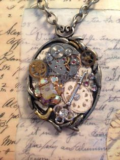 Steampunk Watch Face Necklace with watch face, movement, key, jewels and rhinestones.  This is a steampunk design by LoveEuniceDesigns, $36.00