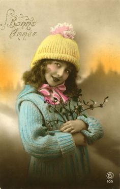 Circa 1920 Vintage (not a reproduction) French hand tinted photo postcard featuring a pretty little girl in winter fashion.  Note on back dated 1920.