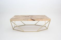 brass + wood coffee table by coil + drift
