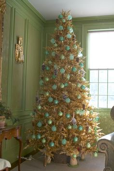 A Closeup Of The Gold Tinsel Tree Adorned With Green Glass Balls And  Frosted Pine Cones. Christmas HolidayCoastal ChristmasVictorian ...