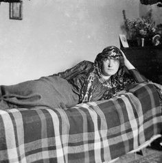 """Poet and Author Katherine Mansfield wearing an """"Arabian Shawl"""" made from assiut. Photo by Ida Baker, 1910.  Alexander Turnbull Library. 1/4-059878-F"""