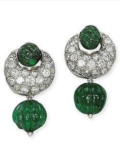 A PAIR OF EMERALD AND DIAMOND EAR CLIPS, BY HERZ-BELPERRON. Each designed as a fluted emerald bead, suspended from a pavé-set diamond crescent and carved emerald bead surmount, circa 1935, 3.1 cm, with French assay mark for gold, designed by Suzanne Belperron, with maker's mark for Atelier Groene et Darde.