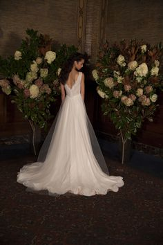 """AS63 """"Magnolia"""" Tulle and Beaded Lace. Tulle A-line gown with delicately scattered beading on lace and skirt. (back)"""