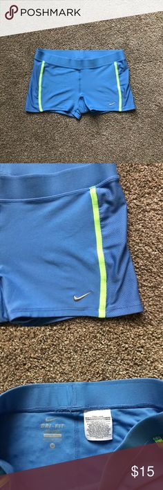 Nike performance dri fit shorts Dri fit shorts, in great condition. Label is a little worn Down but no stains or tears. Blue and neon green, so cute. They are tight fitting but so comfy Nike Shorts
