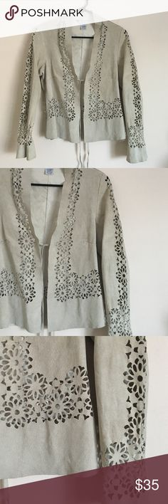 """CAbi XS suede boho flower cut out jacket cream Delicate and feminine yet trendy and fun CAbi cream colored genuine suede boho flower cut out v-neck jacket with a tie front closure. Dimensions taken while garment is laying flat: 15"""" across shoulders, 34"""" bust, 32"""" waist, 36"""" hips, sleeve length 21"""", and length from shoulder to bottom hem 20"""". CAbi Jackets & Coats"""