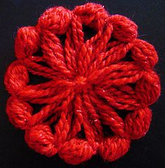 """The sample flower was made on a 3½"""" Studio Twelve Multi-fleur loom with worsted weight yarn and a 4mm crochet hook."""