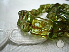 SAVE 10% use coupon code PIN10 SALE MARKED DOWN FROM $2.00.  Gorgeous green or peridot square picasso Czech glass beads, great #bead to add that unique design to your pieces of jewelry.  Quantity: 10   Si... #supplies