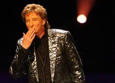 GRAND PRAIRIE - A Barry Manilow song is like an old friend that you didn't realize you missed until the memories come pouring through. So there he was, still holding…