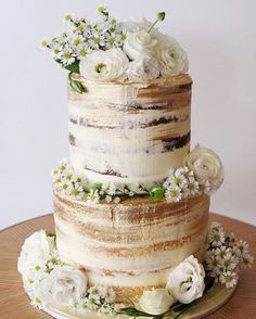 White and Gold Semi-Naked Wedding Cake with Florals