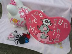 Custom piggy bank stool and ornament Wood letters hand drawn and hand painted www.facebook.com/andbabymakesthreee  and can do any theme or design