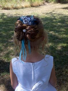 """Flower Girl Hairstyle ~ """"Loops & Braids"""". this is my daughter, anastasia! my sis-in-law, cassandra stone did her hair for my sis's wedding :)"""