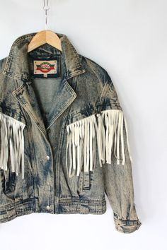 Vintage 80s Acid Wash Denim Jacket with White Leather Western Fringe. $54.00, via Etsy.
