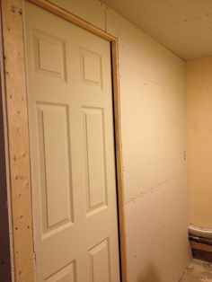Renovated basement bathroom and laundry separation in basement Basement Bathroom, Armoire, Laundry, Furniture, Design, Home Decor, Clothes Stand, Laundry Room, Closet