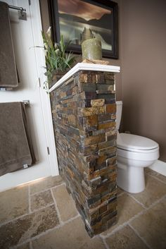 """nice seperation for """"john"""" - the stone idea is great if it is the same used on the exterior or thoughout the house"""