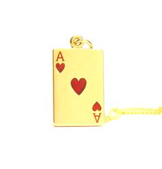An enamelled gold 'Ace of Hearts' pendant