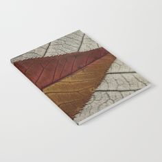 Notebook with my artwork at my Society6 Store. Red and Yellow leaf on a charcoal rubbing. Available lined or unlined.