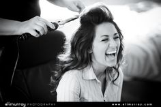 Bride getting hair done for wedding ceremony/ black and white image of bride laughing.  Photo by: Eli Murray Weddings