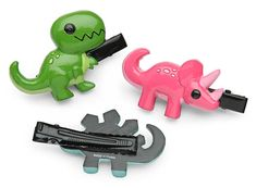 These little Dinosaur Hair Clips come in a set of 6 and include 2 T. Rex, 2 Stegosaurus, and 2 Triceratops. They attach with alligator clips.