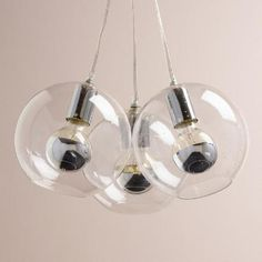 Featuring chrome-tipped bulbs housed in elegant seeded glass globes, our exclusive cluster pendant adds organic warmth to any room. Each clear wire string is independently adjustable for on-the-fly personalization. An incredible value, this exclusive pendant comes complete with all three bulbs.