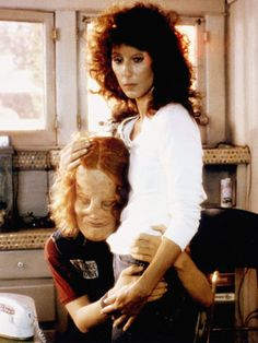 Mask * 1985 film about a boy with a massive facial skull deformity and his biker gang mother, played by Cher.