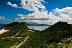 """This was the most beautiful beach landscape I witnessed in the Caribbean. This view on St. Kitts is where the Caribbean Sea and the Atlantic Ocean intersect. Cars climbing the mountain provided an element of scale to show how grand and vast the nature is. The dramatic clouds in the sky made it a perfect shot for me.""  #Caribbean #National_Geographic #St. Kitts"