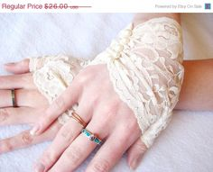 SALE 1/3 off Bridal Gloves: Ivory Wedding gloves, Fingerless Lace gloves,  Pearls, Victorian, wedding, bride, bridesmaids, steampunk, Vinta. $17.42, via Etsy.