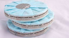 """DIY Seed Tape: Cut strips of newspaper then """"glue"""" them together with seeds placed in between. Glue is 1/4 cup flour with enough water to make paste. Let dry, roll up."""