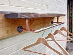 Reclaimed wood wooden shelf with copper pipe clothes rail. Copper Pipe Shelves, Reclaimed Wood Shelves, Rustic Shelves, Wooden Shelves, Industrial Pipe Shelves, Vintage Industrial, Shaker Furniture, Pipe Furniture, Copper Clothes Rail