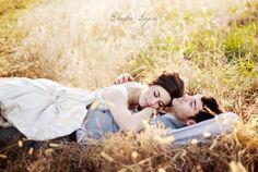 Bride and groom lying in meadow