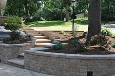 Paver retaining wall and staircase by Norland Landscape Madison, WI
