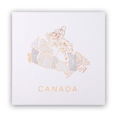 "Canada, redefined. Display your pride of country with a stylish map drawn in graphic black and white with hints of gold. It's printed on smooth, bright white heavy cardstock for a crisp image and enduring beauty. 12"" x 12"". Available only at Indigo."