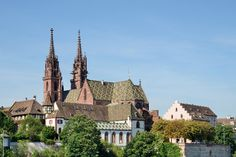 Situated on a hill above the Rhine River, the medieval Basel Minster remains one of the city's major landmarks, its duo of slim towers a dominant feature in the Old Town's skyline. #BaselMinster #traveling #inspirock #inspirocktravel