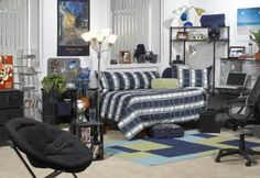 Guys Dorm Room Decorating: This is a great example of a well design guys dorm room. The area rug adds so much to boring flooring, good seperation of zones.