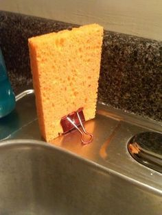 Binder clip to stand the kitchen sponge upright to dry.....smart!