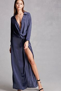 A satin maxi dress featuring an off-center knotted waist, a plunging surplice neckline with a draped front, basic collar, off-center split front with a slit, long sleeves with button cuffs, and an invisible side zipper. This is an independent brand and not a Forever 21 branded item.