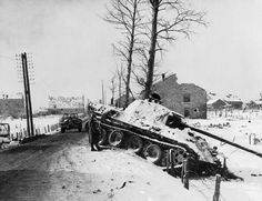 Battle of the Bulge, 1944; An American soldier inspects an abandoned Panther tank of the 2nd SS Panzer Division at Manhay in Belgium, December 1944. The Germans' surprise counter-offensive in the Ardennes achieved some initial success, but was soon contained by US forces. When the weather cleared, Allied air attacks completed the destruction of the German spearheads. Hitler's gamble had drained what was left of his army's manpower in the west.