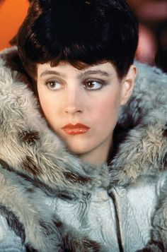 """Sean Young as """"Rachael"""" in Ridley Scott's Blade Runner, The screenplay is written by Hampton Fancher and David Peoples, and it is a modified film adaptation of the 1968 novel """"Do Androids Dream of Electric Sheep?"""" by Philip K. Sean Young Blade Runner, Film Blade Runner, Blade Runner 2049, Rachel Blade Runner, Film Science Fiction, Fiction Movies, Sci Fi Movies, Indie Movies, Blade Runner Wallpaper"""