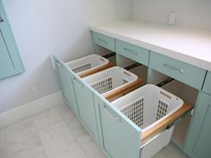 """Sorting bins for lights, darks and towels don't have to be front and center. When Erin Rollins of the blog Sunny Side Up was redoing her laundry room, she created drawers that disguise her plastic baskets. """"Laundry can be such a chore,"""" she says, """"so I wanted a room that made the process as streamlined as possible."""""""
