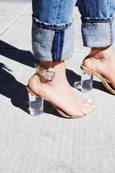 Glass Slipper Heel | Clear plastic strappy heels featuring a clear chunky heel.    * Adjustable ankle strap   * Padded and soft footbed