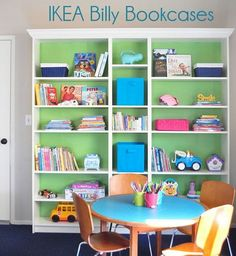 Beautiful IKEA  BILLY Bookcases for Kids. Good transformation by painting the backs in green and adding molding for the plain BILLY bookcase. This is perfect for the playroom!