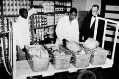 African-Americans worked in the commissary department providing dining cars with the critical supplies to keep passengers fed. In this image, commissary assistants Hendricks Clark and Charles Wright load supplies for Thanksgiving while a manager looks on at the Camden Station Commissary in November, 1960. The Camden commissary supported all dining cars on the eastern end of the B&O. Other commissaries with similar operations were located in Chicago and Cincinnati.