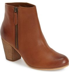 A short side zipper accentuates the abbreviated style of a go-anywhere ankle bootie.