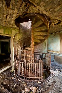 An iron spiral staircase on the eastern tip of the southern wing. This room was originally a screened-in porch. Riverside Hospital (North Brother Island)