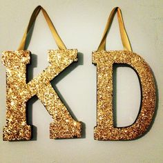 Cute idea for one initial huge wood block letter mod podge and lots of glitter and ribbon!