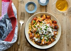 This traditional Sicilian pasta dish of sautéed eggplant tossed with tomato sauce and topped with ricotta salata makes for a satisfying vegetarian dinner, and it can be thrown together in under an hour. (Photo: Sabra Krock for The New York Times)
