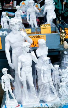 Stock Photo #1850-29422, Italy, Tuscany, Florence, Plaster Souvenir Statues Of David By Michelangelo On A Street Stall.