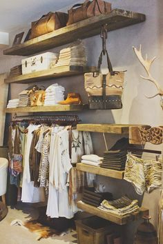 Love the rustic wood shelves. We'll have pretty prop storage like this one day. Minus the antlers