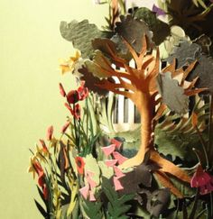 Close-up of a paper garden... there is a lot of intricate cutwork involved in making these.